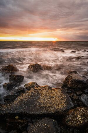 Tempest on the shore: Rough seas along the Whitehead shoreline at dawn. Banco de Imagens