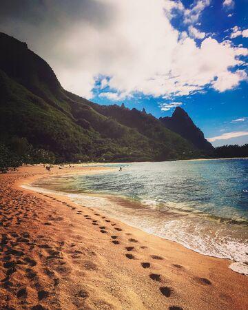 footprints along the beach in Hawaii Stock Photo