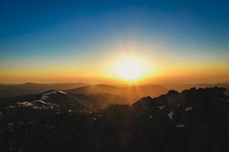 gentle sun rising in the mountains