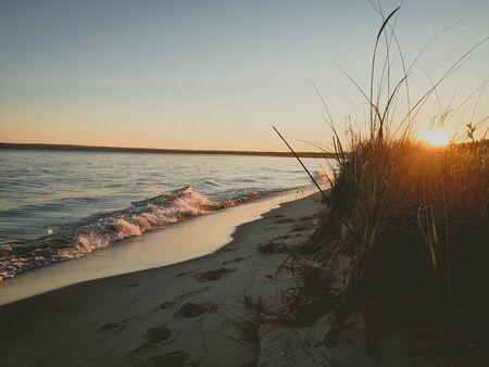 golden sunset on the beach of lake michigan