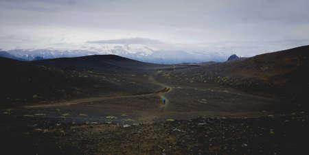 Hiking across black volcanic sand in Iceland