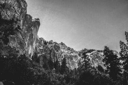 looking up at dramatic black and white cliffs