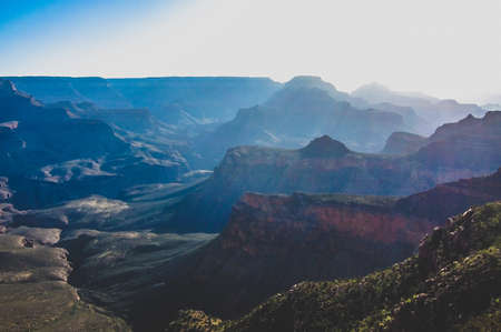 misty layers of sun in a canyon