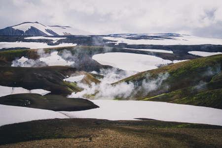 Misty volcanic snow mountain range