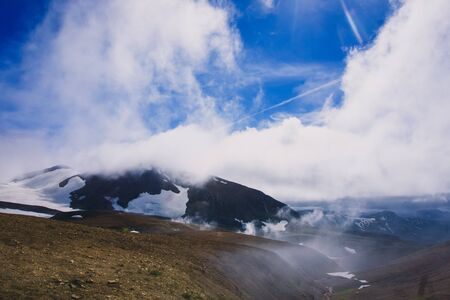 mountaintop in the clouds Stock Photo