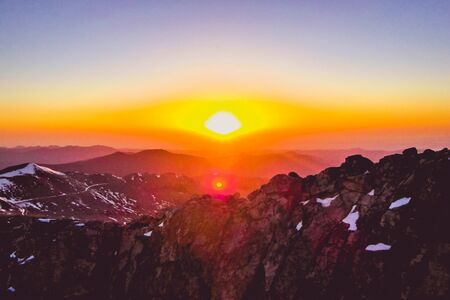 pink and orange sunrise over the mountains