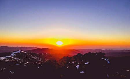 pink sunrise at the mountain summit Stock Photo