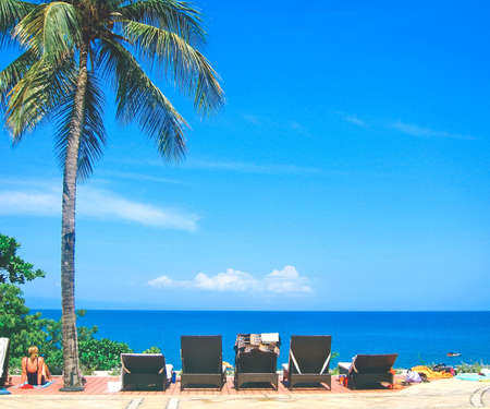 relaxing resort lounge chairs at the beach