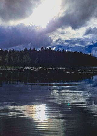 ripples on a stormy reflective lake