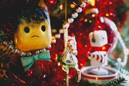 sad toasted marshmallow ornament on a Christmas tree