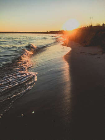sun beam shining on the waves at sunset