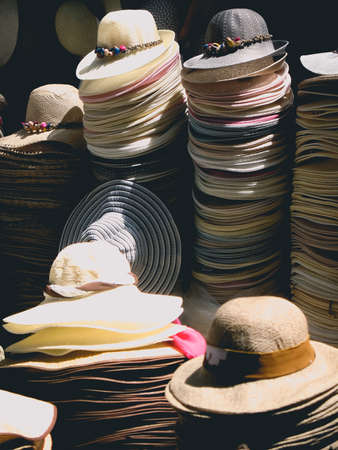sun hats stacked in the market