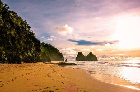 sun setting on colorful beach