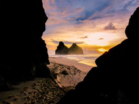 sunset and ocean through the rocks