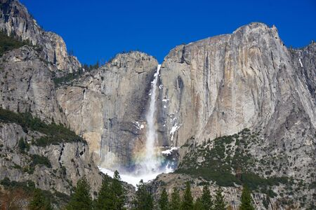 waterfall in Yosemite with a rainbow