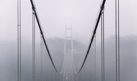 Bridge in Southern China, the worlds highest and longest tunnel to tunnel suspension bridge. Stock Photo