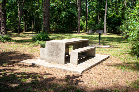 A picnic table and bench in a park