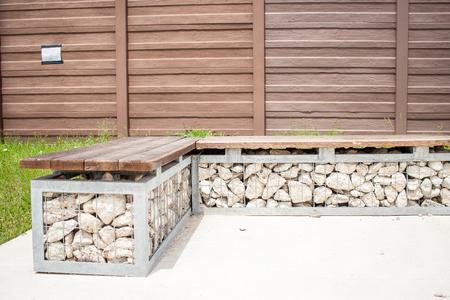 A bench with rocks Stock fotó