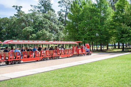 May 2017, Houston, Texas:  People ride the Hermann Park train