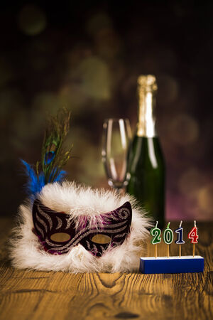 Carnival mask , glasses  champagne bottle  and 2014 wording  photo
