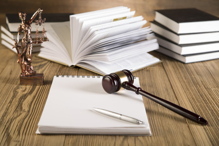 Goddess of justice, final speech, notebook, wooden   gold gavel and books on wooden table on brown wooden  Zdjęcie Seryjne