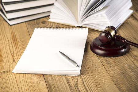 criminal lawyer: Final speech, wooden   gold gavel and books on wooden table on brown wooden