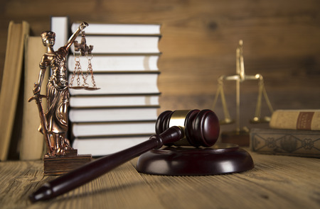 Golden scales of justice, final speech, wooden   gold gavel and books on wooden table on brown wooden Zdjęcie Seryjne - 28814082