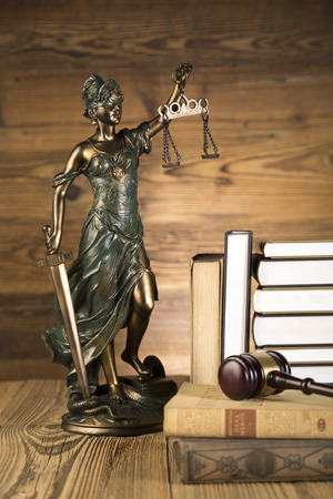 Lady of justice, final speech, notebook, wooden   gold gavel and books on wooden table on brown wooden Zdjęcie Seryjne - 28814084