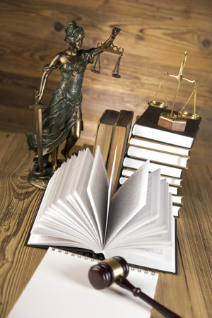 Golden scales of justice, final speech, wooden   gold gavel and books on wooden table on brown wooden Zdjęcie Seryjne - 28814088