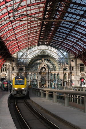 2018-10-01 Antwerp, Belgium: Platforms and train hall with iron and glass vaulted ceiling of Antwerp Central Station.