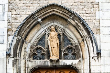 Ponted arch transom window and statue of St. Barbara