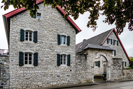 Traditional farmhouse built around central compound, in the historic village centre of Alt Breinig Editorial