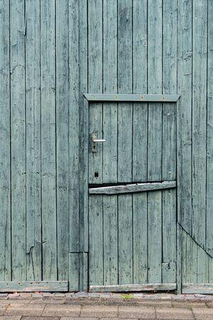 Green painted wooden Dutch Barn Door - vertical