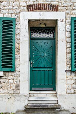 Green ornamented front door Editorial
