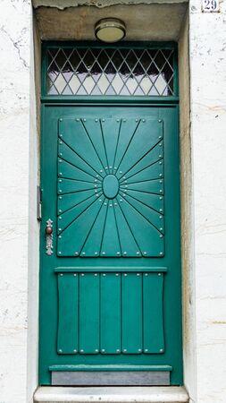 Green ornamented front door - close-up