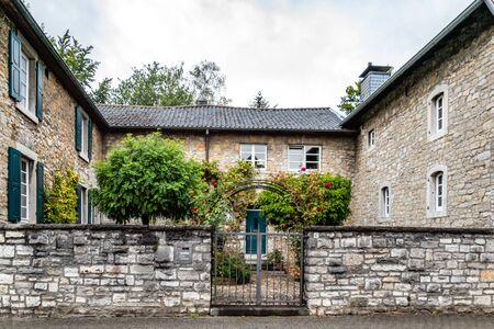 Historical farm with entrance gate leading to central compound. Alt Breinig, DE Editorial