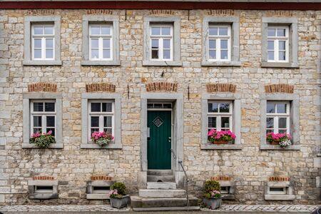 Flowered facade of a historical mansion house. Alt Breinig - DE