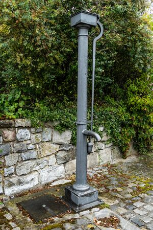 Last traditional village pump from the 19th century in the historic village centre of Alt Breinig. Editorial