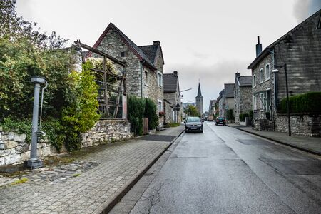 View on the main street with last traditional village pump Editorial