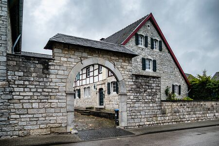 Traditional farmhousewith arched entrance gate in the historic village centre of Alt Breinig