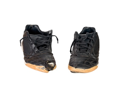 Old running shoes on a white background. Stock Photo - 9919504