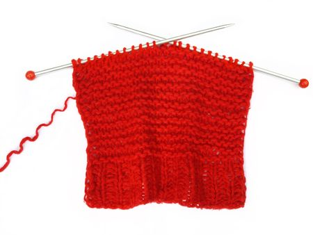 Red knitting on white background