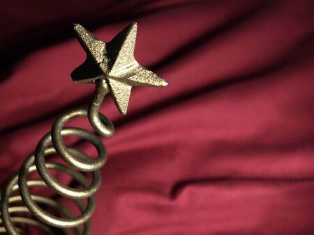 Metallic, textured tree topper star     photo