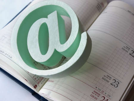 An e-mail symbol standing on the calendar. Stock Photo