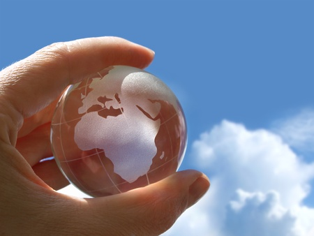 glob: Hand holding a transparent little globe.