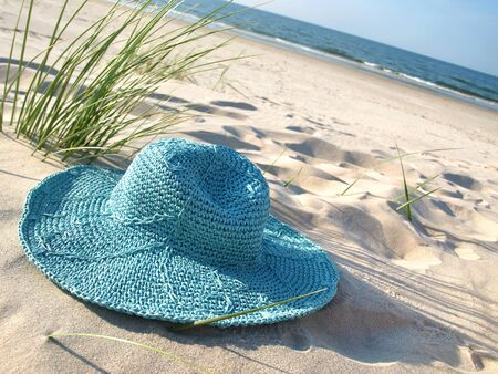 A turquoise straw hat on Baltic beach.