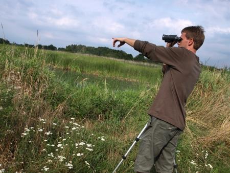 birdwatcher: birdwatching on the swamp Stock Photo