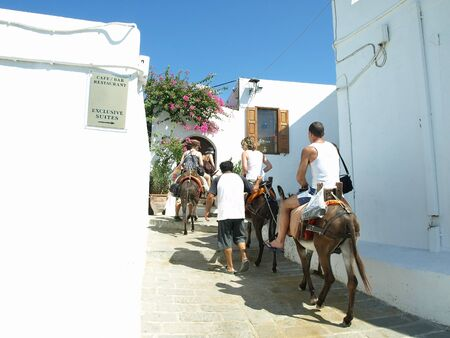 Donkey ride to the Acropolis at Lindos, Rhodes, Greece  Stock Photo