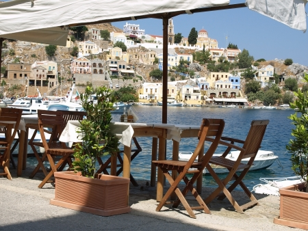 Small tavern in Yialos, Symi island, Greece  Stock Photo