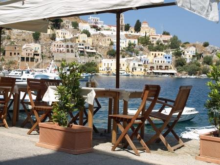 Small tavern in Yialos, Symi island, Greece  Stock Photo